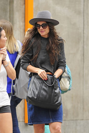 Katie Holmes completed her casual ensemble with a gray cross-body tote as she spent a day out in New York City.
