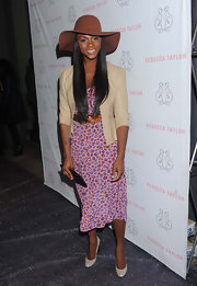 Tika Sumpter finished off her demure look with a pair of nude pumps.