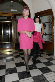 Katy Perry paired her bright pink dress with classic black stilettos.