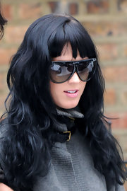 Newly engaged pop singer, Katy Perry is seen here with fiance Russell Brand in London wearing a pair of sporty black shield sunglasses.