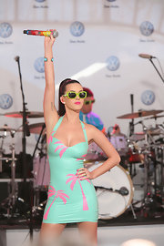 Katy hit the stage sporting plastic neon novelty shades with a fitted mini dress.