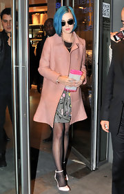 Katy Perry was pretty in pink while shopping in Paris wearing a rosy coat with a flared hem.