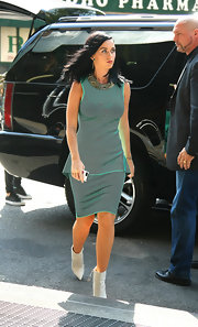 Katy Perry sported an elegant teal dress with a figure-flattering peplum detail while out in NYC.