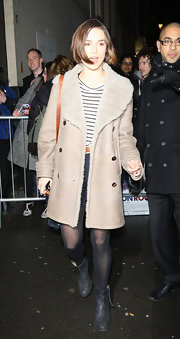 Keira Knightley met with fans outside the Comedy Theatre in black leather ankle boots.
