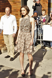 Keira Knightley teamed her textured Valentino halter dress with pheasant feathered ankle strap heels from the Fall 2011 collection.