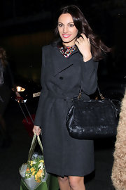 Kelly Brook looks posh with a ruffled leather handbag. The ladylike purse matched the vibe of her charcoal wool coat.