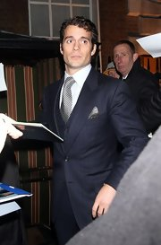 Henry Cavill looked dapper and pulled-together in a pin strip suit and geometric-patterned tie.