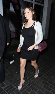 Kelly Brook teamed her fitted black mini dress with white snakeskin platform slingbacks.