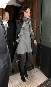 Kelly Brook kept warm in a pair of black suede mid-calf boots. The boots' chain-trim gives them a slight edge.