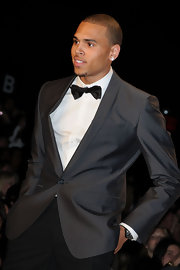 Chris Brown played up his youthful vibe in a fun bowtie as he strutted down the runway for charity.