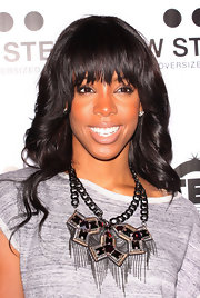 Kelly Rowland wore her hair in long curls with sexy lash-grazing bangs at the TW Steel party in London.
