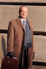 Kelsey Grammer accessorized his tan coat with a striped gray wool scarf while filming in Manhattan.