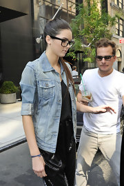Kendall Jenner sported a pale jean jacket with cuffed sleeves over a silky black camisole in NYC.