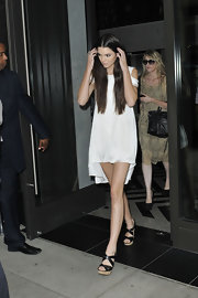 Kendall Jenner was a vision in white in NYC wearing a mini dress with cutout shoulders and an asymmetrical hem.