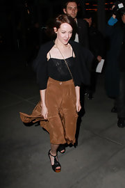 Jena Malone paired her flowy skirt with black peeptoe sandals with wooden platforms.