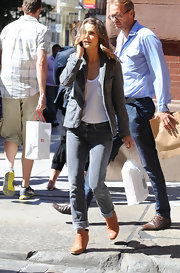 Keri Russell added some brightness to her gray outfit with a pair of camel-colored ankle boots.