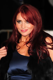 Amy Childs paired her dramatic eye makeup with soft pink lipstick.