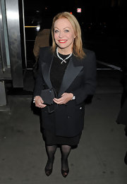 Jacki looks ultra sophisticated in a tuxedo style blazer and black skirt for the New York Film Critics Awards.