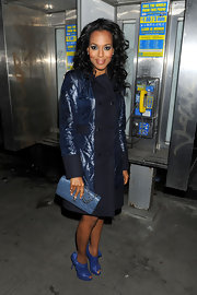 Kerry was blue all night in a knee length pea coat.