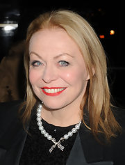 Jacki dolls up her black ensemble with a faux pearl and bow necklace at the Critics Circle Awards in New York.