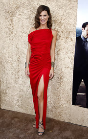 Perrey looked like a movie star in a sexy crimson dress with metallic Lance sandals.