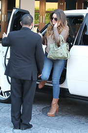 Khloe Kardashian embraced the uber-hot mint trend with a baby motorcycle-style Balenciaga bag.