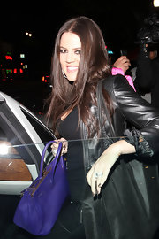 For a night out with Lamar, Khloe rocked an all-leather look with a vibrant purple Birkin.