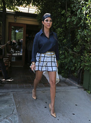 Kourtney Kardashian looked very dressy in patterned black-and-white shorts and a blue blouse as she left Ago Restaurant.