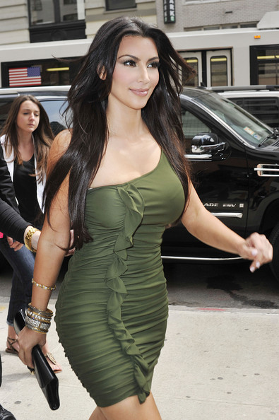 Kim Kardashian shows off her curves in a form fitting olive green off the
