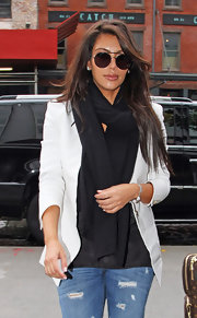 Kim Kardashian accessorized with a pair of round sunnies by Tom Ford.