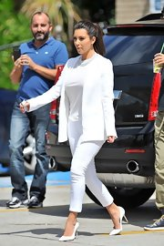 Kim Kardashian wore all white to match her kitty on the way to the groomers in Miami.