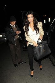 "Kim keeps it glamorous with a sequined jacket and a ""Birkin"" bag as she dines with pal, Eva Longoria Parker."