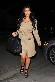 """Kim K. has been seen carrying this """"Birkin"""" bag all over the globe. It's hard to believe she didn't pack another handbag for her extensive travels."""