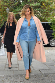 Kim Kardashian was unafraid to rock the denim-on-denim look, pairing her button-down with washed-out skinny jeans.