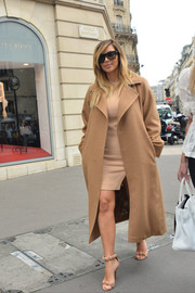 Kim Kardashian completed her ensemble with a pair of chic nude sandals.