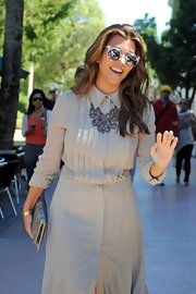 Kourtney's pretty floral necklace added a dose of vintage charm to her classic shirtdress.