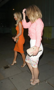 Kimberley Walsh accessorized her chic outfit with a nude leather clutch during a night out in London.