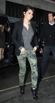 Cheryl Cole did anything but blend in while wearing these chic camo-print ankle-zip jeans.