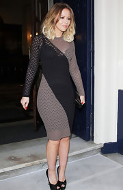Kimberly Walsh chose this black and gray striped long-sleeve dress to show off her curves while out in London.