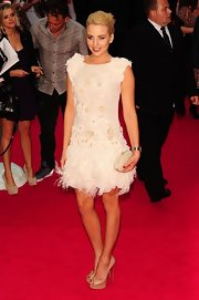 Lydia Bright wowed the crowd at the UK premiere of 'Katy Perry Part Of Me' in a frilly white cocktail dress.