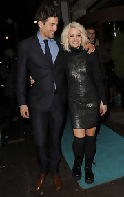 Kimberly Wyatt opted for a sleek and modern black dress with silver detailing for her evening look while out in London.