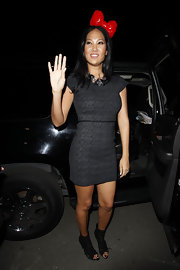 The queen of over the top fab style looks demure in cutout lace ankle boots. A red Hello Kitty bow is oh so Kimora.