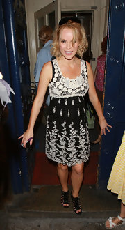 Amanda Holden wore a sweet black dress with white lace and embroidery for a ghost tour of London.