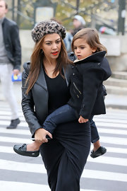 Kourtney blended in with Parisian culture in a fuzzy leopard-print beret.