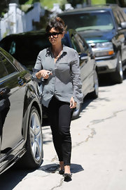 To top off her look, Kourtney opted for black skinny jeans.