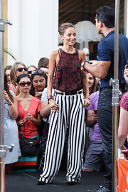 Nicole Richie gets crazy with prints when she sports this maroon-and-black printed blouse with a striped pant.