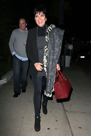 Mama Kardashian, Kris Jenner is seen out and about in LA toting around a classic Hermes bag in a dashing red color.