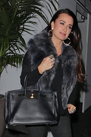 Kyle Richards carried this classic black leather tote out to dinner with friends.