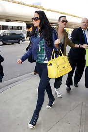 Tulisa Constostavlos brightened her pretty look with a purple leather jacket and a bright yellow bag.