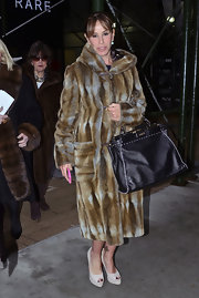 Snapped as she exited the the Fashion26 Hotel with Mom Joan, Melissa Rivers braved the chilly NYC temperature in an opulent fur coat.